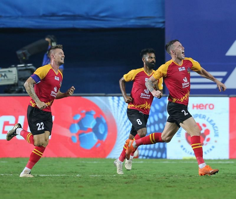 SC East Bengal players Anthony Pilkington (left), Mohammed Rafique (centre), and Scott Neville (right) celebrate after latter scores against Kerala Blasters (Image Courtesy: ISL Media)