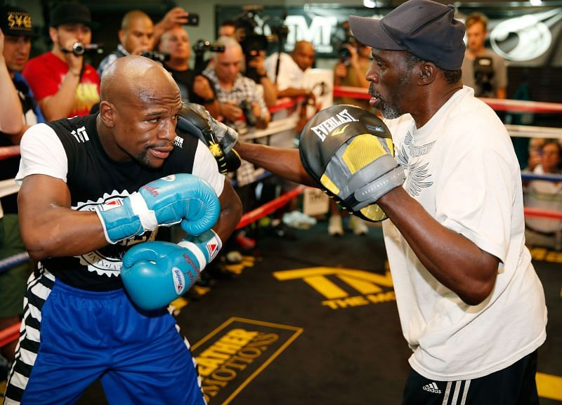 Floyd Mayweather Jr. with Roger Mayweather