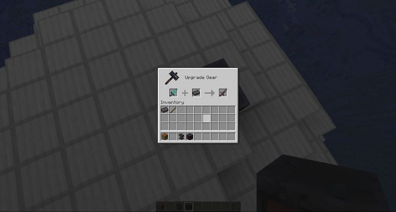 Crafting a netherite sword in Minecraft
