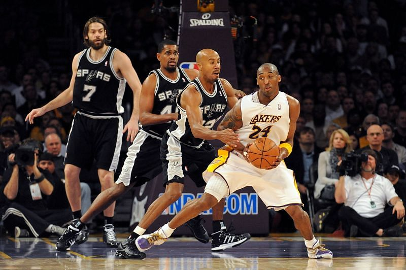 Kobe Bryant #24 of the Los Angeles Lakers moves the ball against Bruce Bowen #12 of the San Antonio Spurs.
