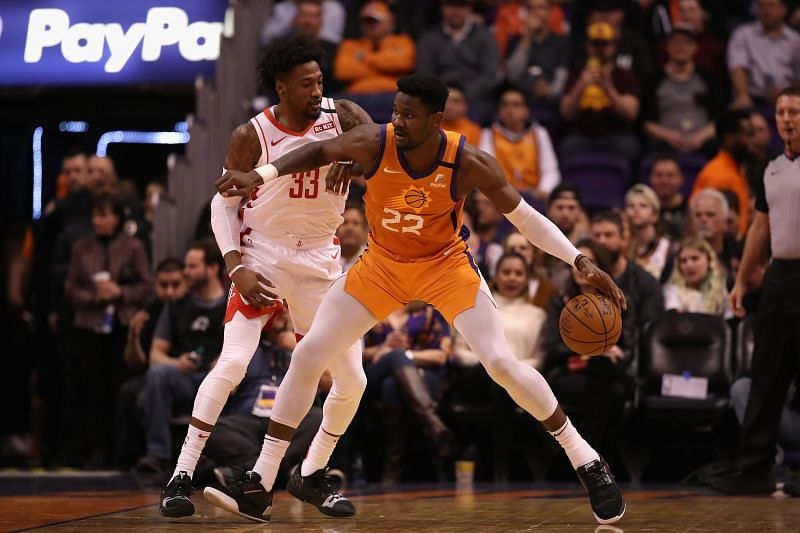 Deandre Ayton of the Phoenix Suns handles the ball against Houston Rockets during an NBA game