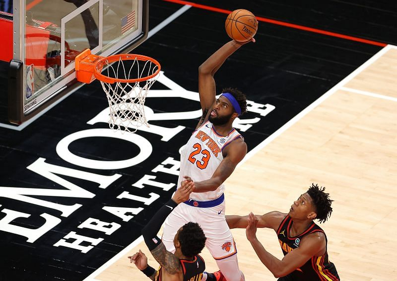 Mitchell Robinson of the New York Knicks dunks an alley-oop pass.