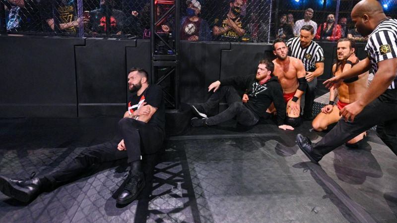 Finn Balor and Undisputed Era after the brawl in the main event.