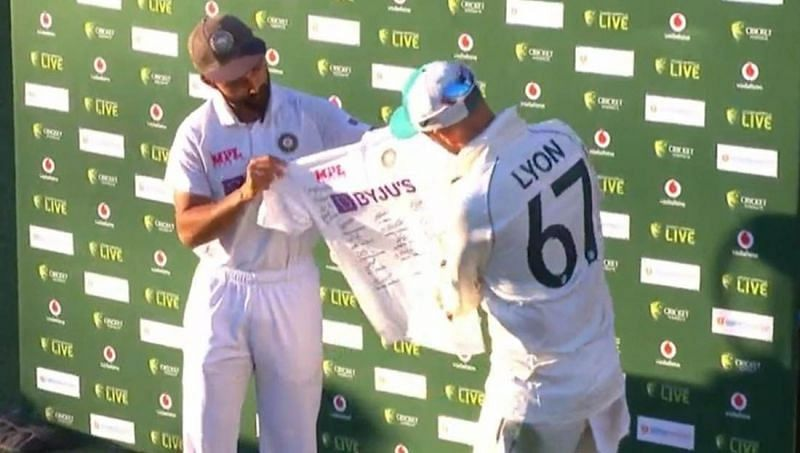 Ajinkya Rahane presented Nathan Lyon with a jersey signed by the Indian players. after the Gabba Test