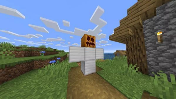 add the carved pumpkin or jack o lantern as its head