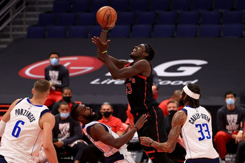 Pascal Siakam #43 of the Toronto Raptors shoots over Tim Hardaway Jr. #11 of the Dallas Mavericks during a game at Amalie Arena on January 18, 2021 (Photo by Mike Ehrmann/Getty Images)