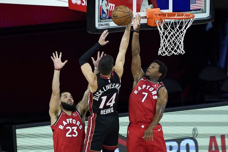 Tyler Herro #14 of the Miami Heat shoots between Fred VanVleet #23 and Kyle Lowry #7 of the Toronto Raptors during a game at HP Field House on August 3, 2020 (Photo by Ashley Landis-Pool/Getty Images)