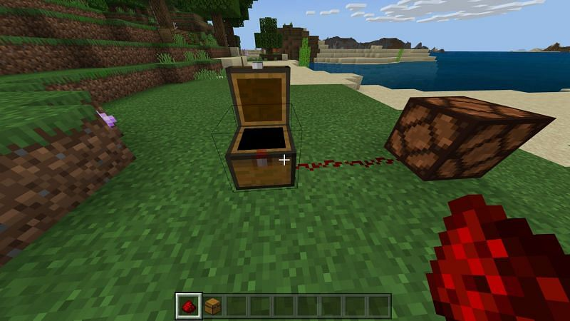 Opening the trapped chest to activate the redstone pulse