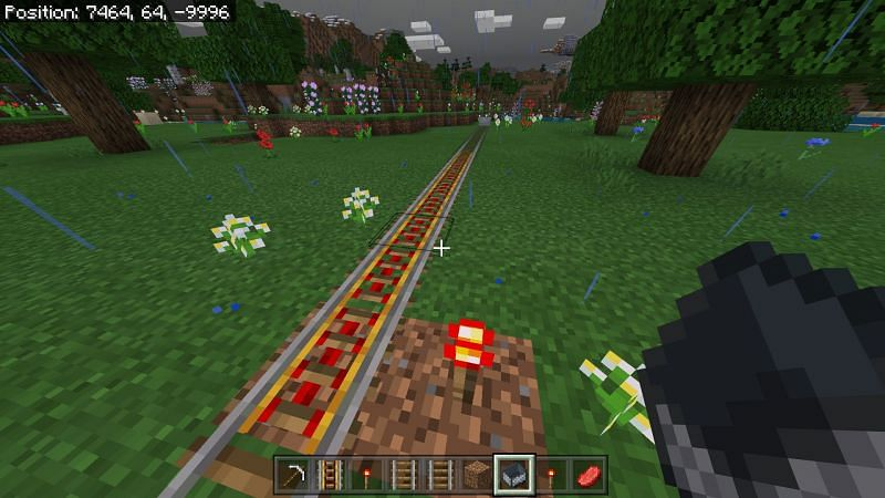 powering any adjacent rails up to nine rails with a torch