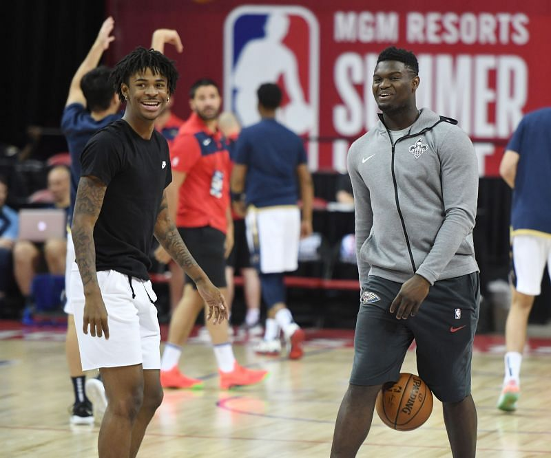 Ja Morant (L) of the Memphis Grizzlies and Zion Williamson #1 of the New Orleans Pelicans shoot during warmups.