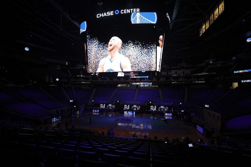 Stephen Curry #30 of the Golden State Warriors are shown on the big screen before their game against the Portland Trail Blazers at Chase Center