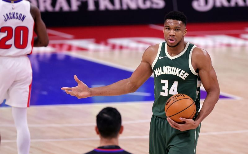Giannis talks to the referee in a game against the Detroit Pistons