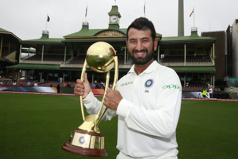 Cheteshwar Pujara with the Border-Gavaskar Trophy