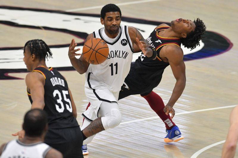 Kyrie Irving #11 of the Brooklyn Nets runs into Collin Sexton #2 of the Cleveland Cavaliers during the fourth quarter at Rocket Mortgage Fieldhouse on January 20, 2021 in Cleveland, Ohio. (Photo by Jason Miller/Getty Images)