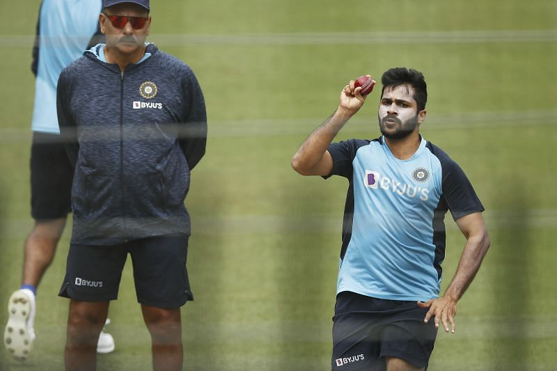 Shardul Thakur bowling under the eyes of head coach Ravi Shastri during a nets session