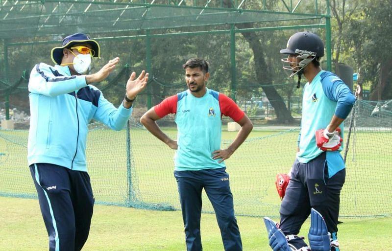 VVS Laxman (left) with Anustup Majumdar (center) during a nets session (Image Credits: CAB)