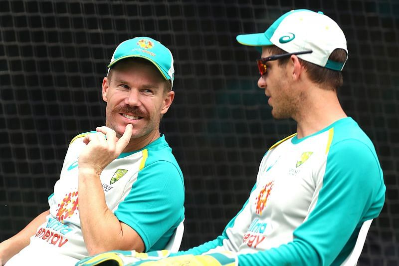 David Warner (L) chatting with skipper Tim Paine (R) during the latest nets session