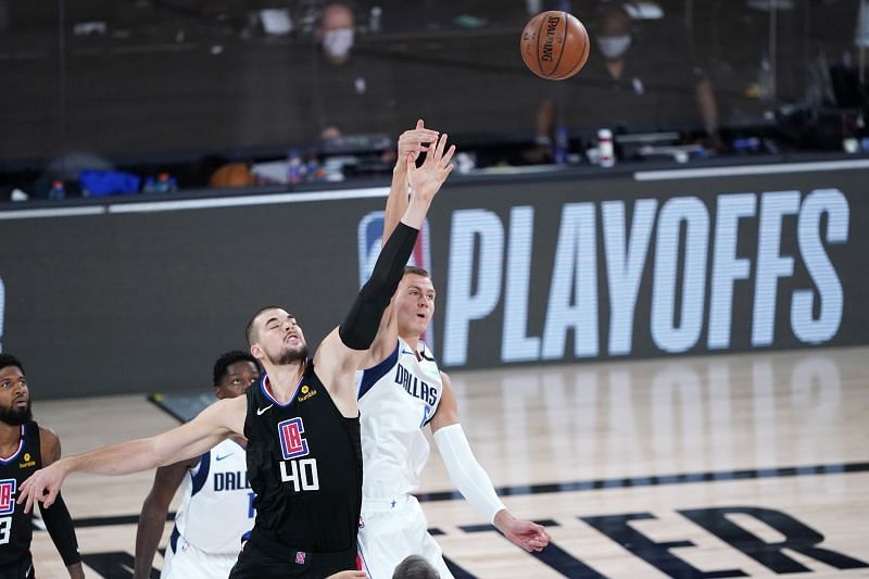 Ivica Zubac of the LA Clippers and Kristaps Porzingis of the Dallas Mavericks battle for the tip off in game two of the first round of the NBA playoffs