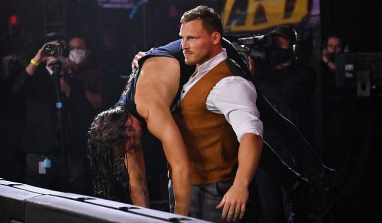 Ridge Holland carrying a beaten Adam Cole at TakeOver 31