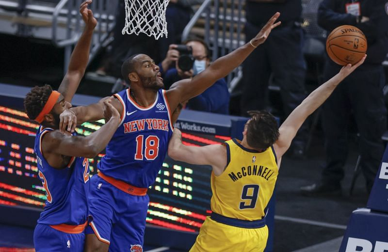 Alec Burks of the New York Knicks defends against T.J. McConnell of the Indiana Pacers