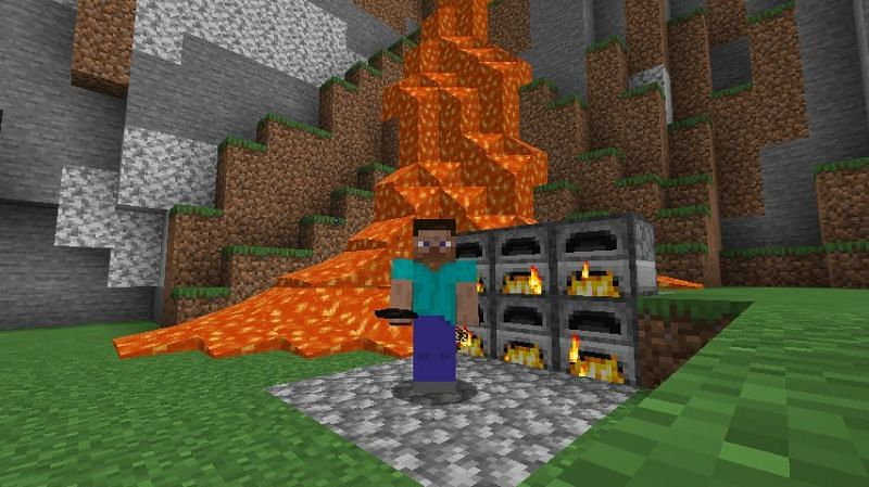 Steve holding charcoal while surrounded by lava and furnaces in Minecraft. (Image via Minecraft)