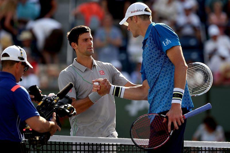 Novak Djokovic (L) and John Isner