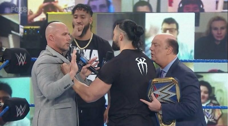 Adam Pearce and Roman Reigns.