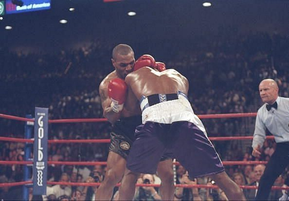 Mike Tyson biting Evander Holyfield