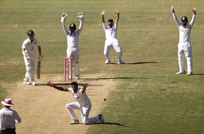 Ravichandran Ashwin dismisses David Warner at Sydney.