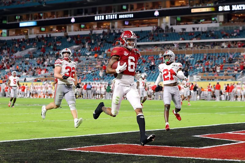 Smith scoring one of his three first-half touchdowns in the CFP Championship