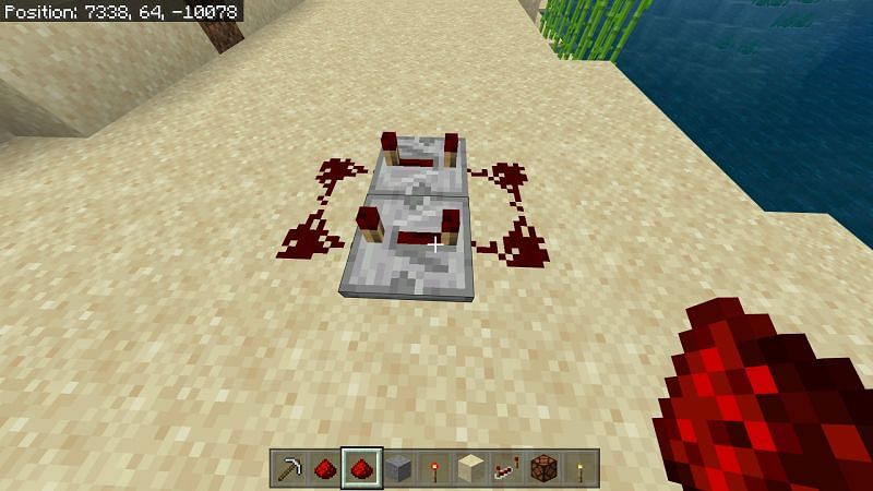 two redstone repeaters and dust connecting to both of them