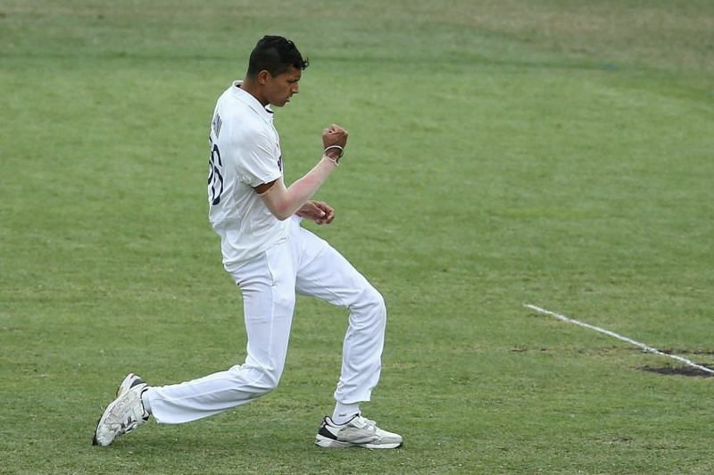 Navdeep Saini celebrates after picking up his maiden Test wicket, dismissing Will Pucovski.