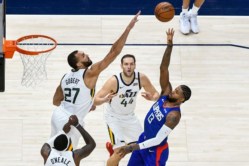 Paul George #13 of the LA Clippers attempts a shot over Rudy Gobert #27 of the Utah Jazz during a game at Vivint Smart Home Arena on January 1, 2021 in Salt Lake City, Utah.