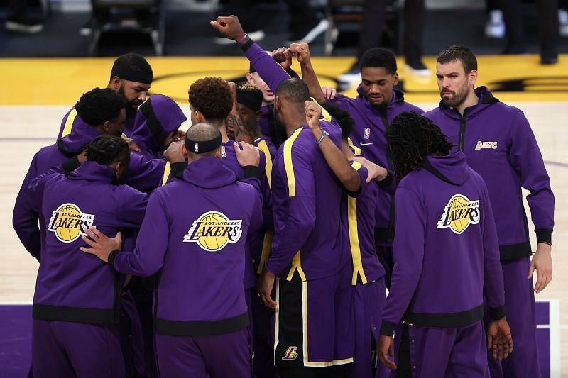 LeBron James #23 of the Los Angeles Lakers gathers his teammates before a game against the Chicago Bulls at Staples Center.
