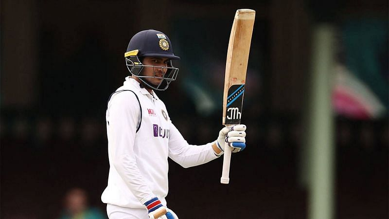 Shubman Gill raises his bat following his maiden Test fifty in Sydney.