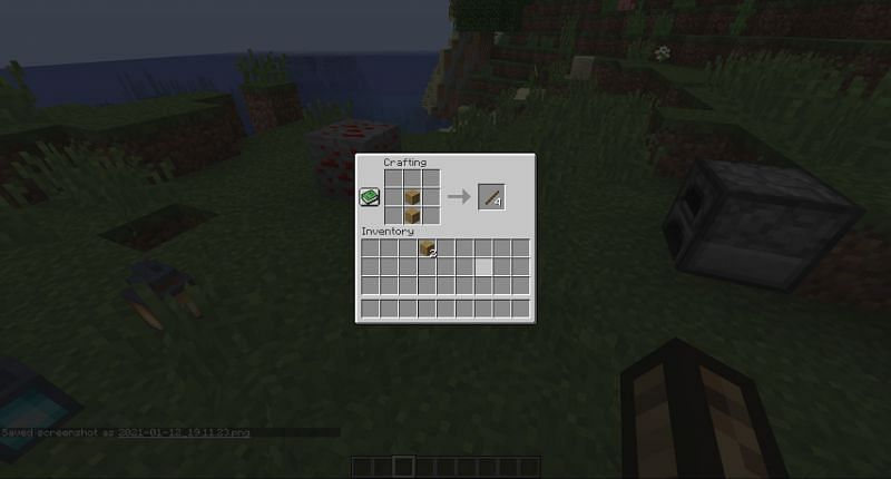 Step 3 for making a wooden bow in Minecraft