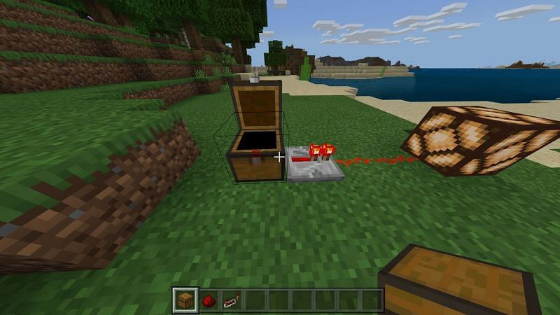 Placing the redstone repeater next to the chest to extend the pulse