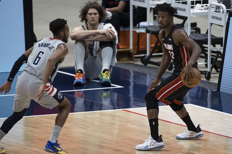 Jimmy Butler #22 of the Miami Heat dribbles the ball as Troy Brown Jr. #6 of the Washington Wizards defends during the second half at Capital One Arena on January 9, 2021 (Photo by Scott Taetsch/Getty Images)