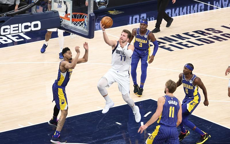 Luka Doncic of the Dallas Mavericks shoots the ball against the Indiana Pacers at the Bankers Life Fieldhouse