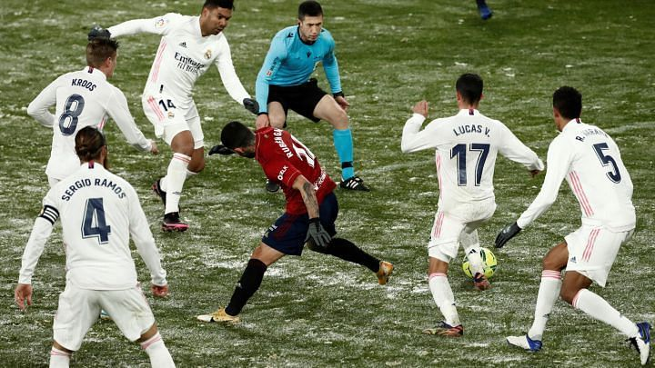 A snowy pitch marred the game as Real Madrid and Osasuna played out goalless draw.