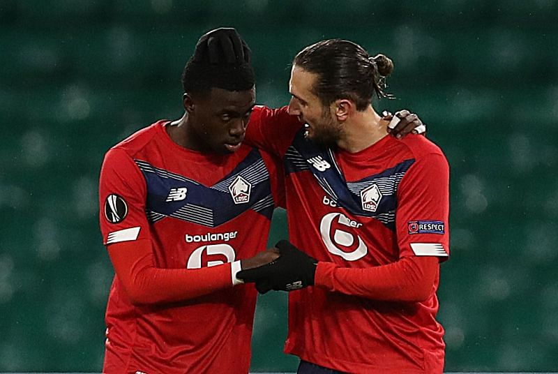 Timothy Weah of Lille celebrates with Yusuf Yazici