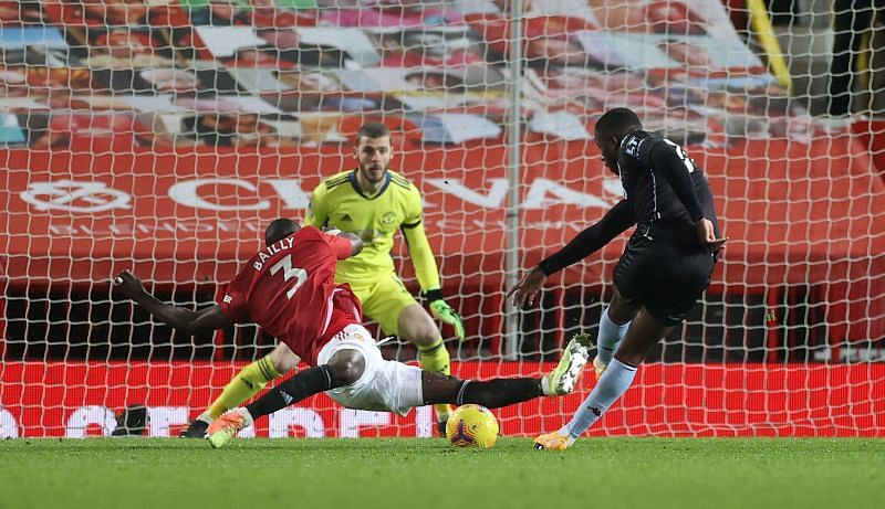 Eric Bailly with a last-ditch challenge in the dying embers of the game against Aston Villa