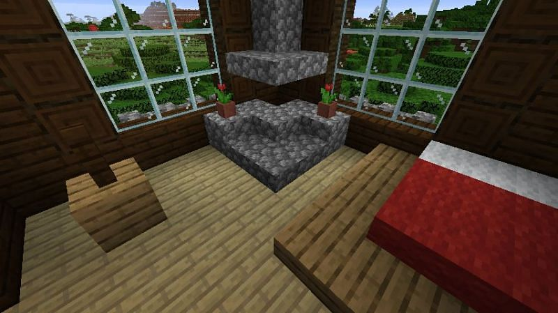 A bedroom in Minecraft that has been decorated with two flower pots (Image via Minecraft)