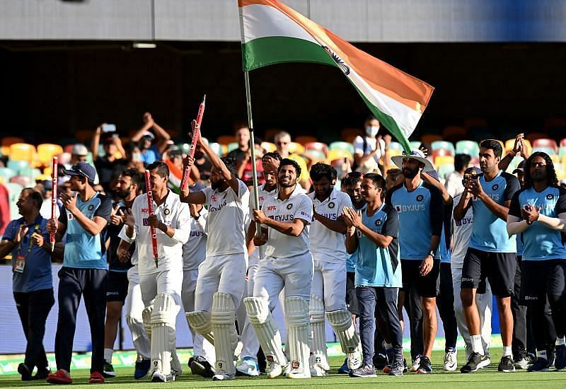 Indian players celebrate with the Tricolor after their historic win at the Gabba