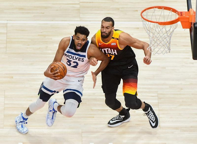 Karl-Anthony Towns #32 of the Minnesota Timberwolves drives against Rudy Gobert #27 of the Utah Jazz (Photo by Alex Goodlett/Getty Images)