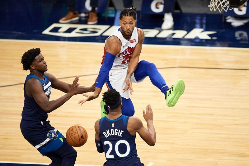 Derrick Rose of the Detroit Pistons passes the ball away from Anthony Edwards and Josh Okogie of the Minnesota Timberwolves during the season-opening game at Target Center on December 23, 2020. (Photo by Hannah Foslien/Getty Images)