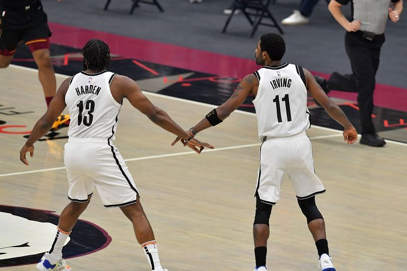 James Harden and Kyrie Irving  of the Brooklyn Nets celebrate a play against the Cleveland Cavaliers