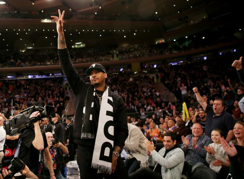 Former New York Knicks player Carmelo Anthony waves to the fans at Madison Square Garden