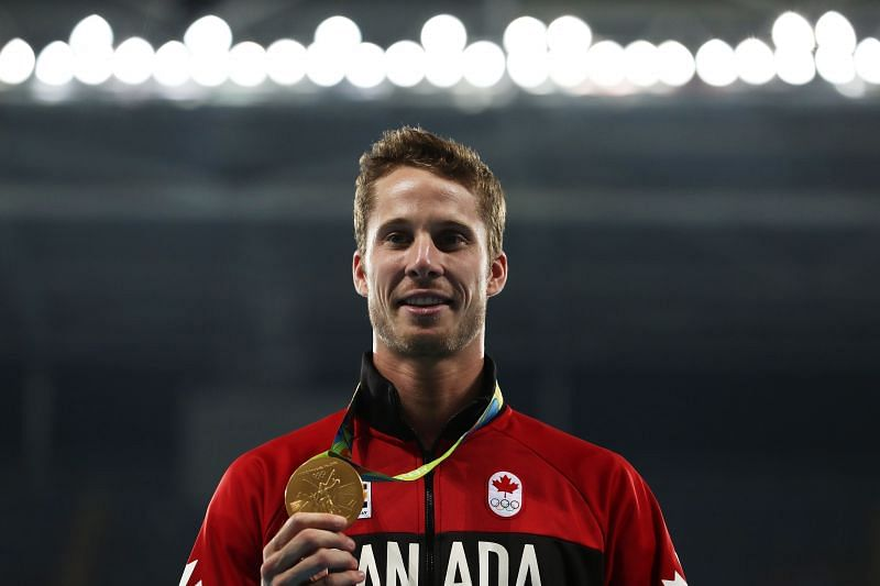 Gold medalist Derek Drouin of Canada poses during the medal ceremony for the Men