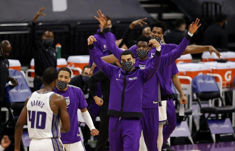 Justin James #10 of the Sacramento Kings celebrates with teammates on the bench
